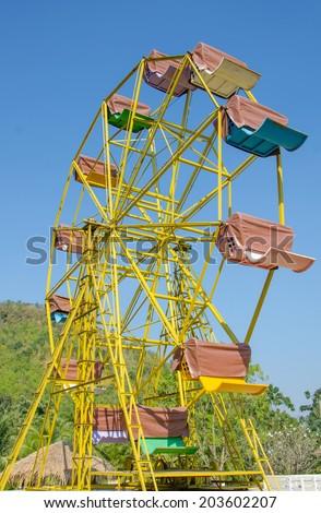 ferris wheel and blue sky. - stock photo