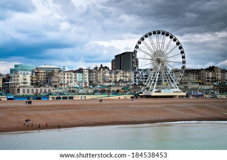 Ferris wheel and cityscape of Brighton in England - stock photo
