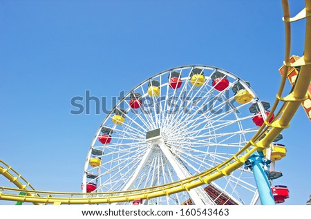 Ferris Wheel and Roller Coaster Track - stock photo