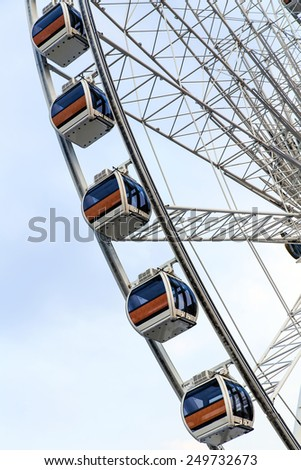 Ferris Wheel and sky background. - stock photo