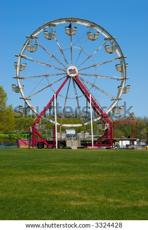 Ferris wheel at a carnival in the springtime - stock photo