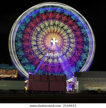 Ferris wheel at a funfair at night - stock photo