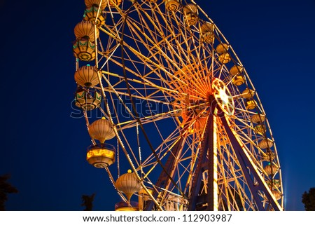Ferris Wheel at amusement park - stock photo