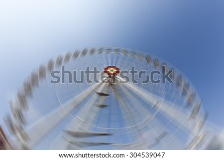 Ferris Wheel at amusement park,blurred rotation ferris - stock photo