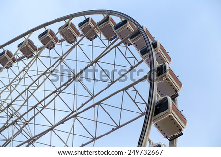Ferris Wheel at Amusement park with blue sky background.  - stock photo