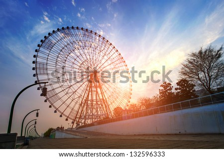 Ferris wheel at dusk - stock photo