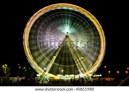 Ferris wheel in a dark sky - stock photo