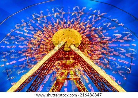 Ferris Wheel motion at nigh. HDR image. - stock photo
