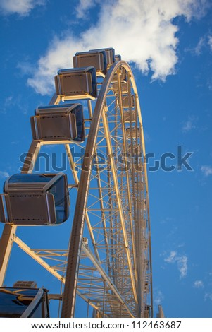 Ferris wheel near sunset - stock photo