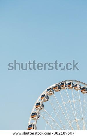 Ferris wheel on a bright sunny day - stock photo