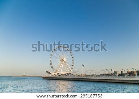 Ferris wheel on Baku seaside boulevard - stock photo