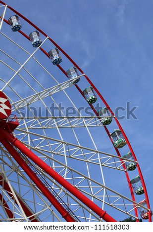 ferris wheel on blue sky background - stock photo