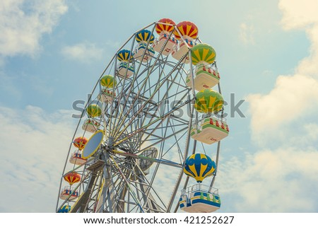 Ferris wheel on the background of blue sky. - stock photo