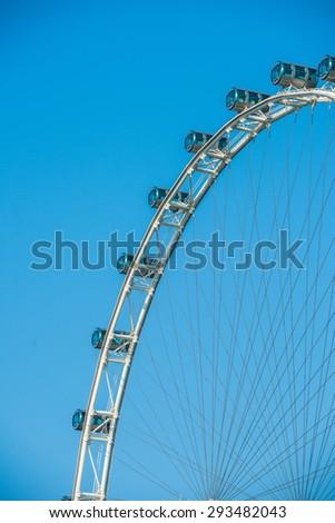 Ferris Wheel on the background of blue sky, Singapore - stock photo