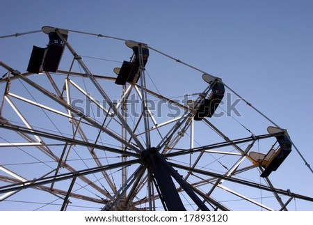 Ferris Wheel over blue skies - stock photo