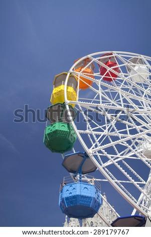 Ferris wheel over blue sky - stock photo