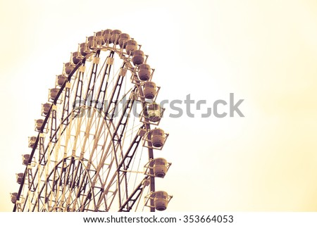 Ferris Wheel Over Blue Sky in vintage retro picture style. - stock photo