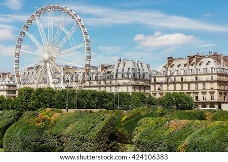 Ferris wheel (Roue de Paris) at Place de la Concorde in Paris, France. Roue de Paris at spring in Paris, France. Ferris wheel in Paris. Sunny day in Paris, France. Paris scene. Paris sights. Paris day - stock photo