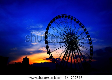 Ferris wheel Sunset. - stock photo