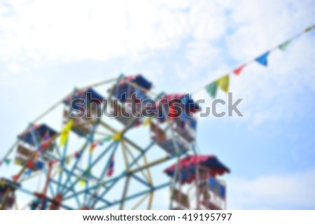 Ferris wheel ,Thai old style.(blur focus)  - stock photo