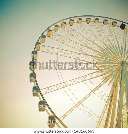 Ferris wheel with blue sky with retro filter effect - stock photo