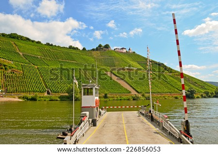 Ferry across the river Moselle to Marienburg Castle near village P�¼nderich - Moselle wine region in Germany - stock photo