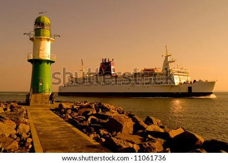 ferry and lighthouse - stock photo