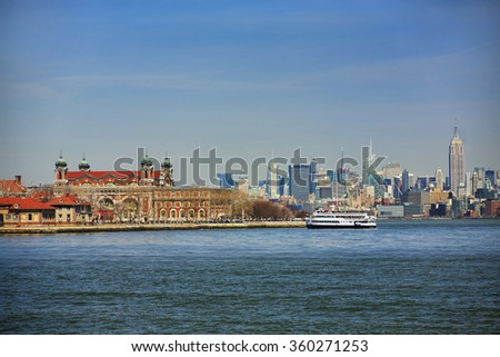 Ferry Arriving at Ellis Island, New York - stock photo