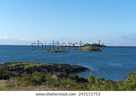 Ferry boat at the rugged rocky coastline, Norway - stock photo