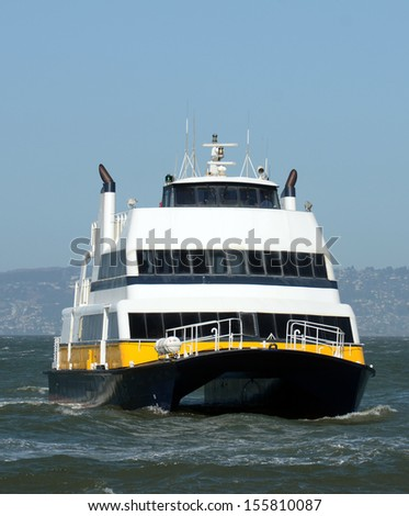 Ferry boat carrying passengers in the San Francisco Bay - stock photo