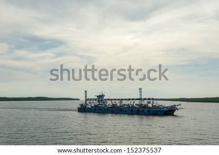 Ferry Boat Taking Cars and Trucks Crossing the Harbor. - stock photo