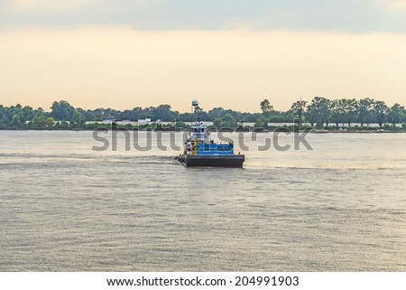 Ferry crossing Mississippi river at sunset in Baton Rouge - stock photo
