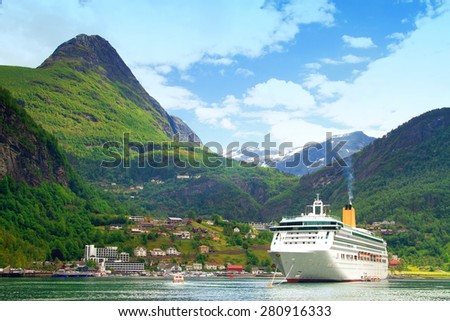 Ferry in Geiranger. bay in the Norwegian mountains - stock photo