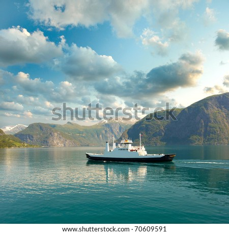 Ferry in the fjord - stock photo