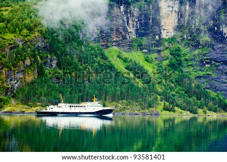 Ferry in the Geiranger fjord, listed as a UNESCO World Heritage Site - stock photo
