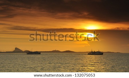Ferry in the sea sunset - stock photo