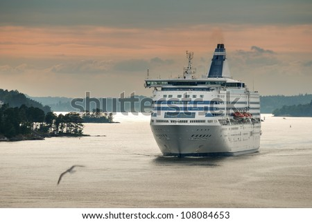 Ferry leave water area of Stockholm port. - stock photo