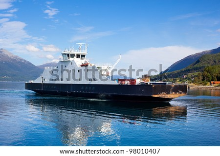 Ferry over fjord in Norway. - stock photo