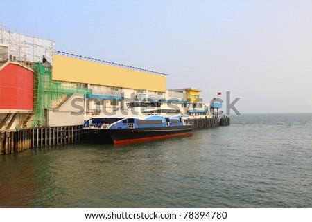 Ferry pier with ship to Macau - stock photo