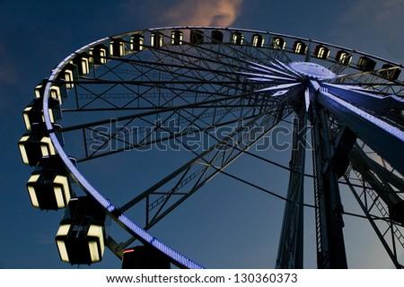 Ferry Wheel on Blue Sky - stock photo