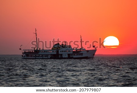 Ferryboat in izmir at sunset - stock photo