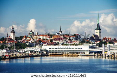 Ferryboat terminal and historical center of Tallinn city in Estonia - architecture background - stock photo