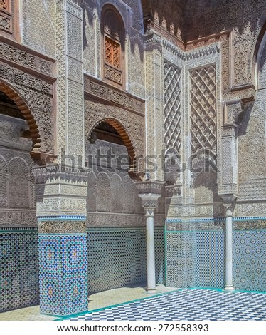 Fes, Morocco - May 11, 2013: Moroccan Carved Plaster Arabesque and mosaic in the 14th century  El Attarine Medersa in Fez, Morocco - stock photo