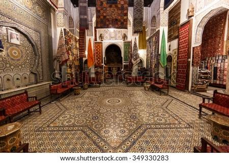 FES, MOROCCO - NOVEMBER 1, 2015: Historical carpet store in Fes Medina, Morocco - stock photo