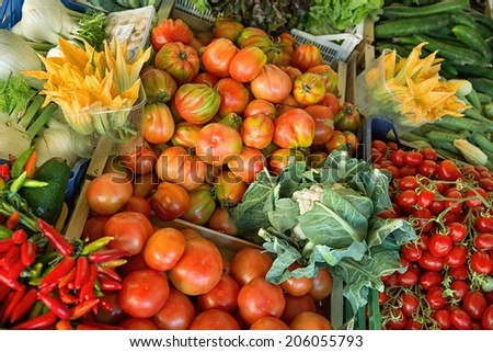 Fesh organic fruits and vegetables on market stall  - stock photo