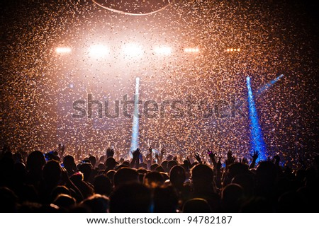 Festival Crowd Confetti Explosion - stock photo