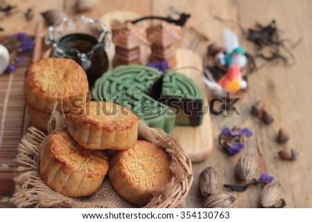 Festival moon cake - china dessert with green tea - stock photo
