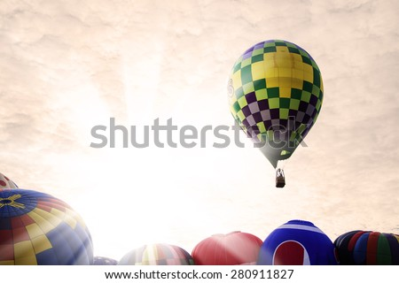 Festival of hot air balloons in the glow of the morning sun.   - stock photo