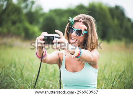Festival people taking self portrait - stock photo