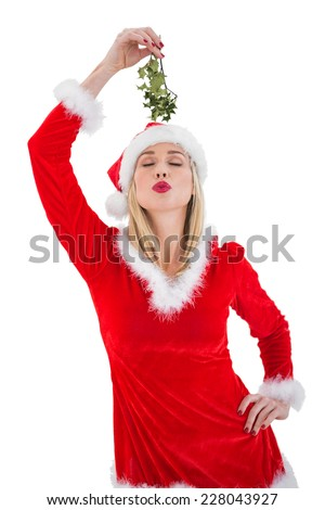 Festive blonde holding some mistletoe on white background - stock photo